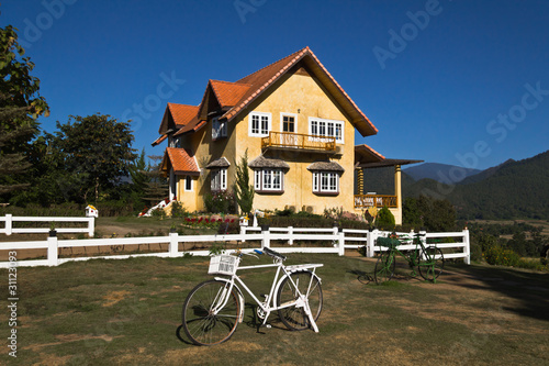 Yellow classic house on hill in pai district Wallpaper Mural