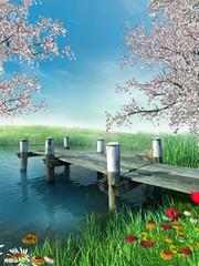 Obraz na Szkle Woda Krople Molo z wiosennymi kwiatami i drzewami