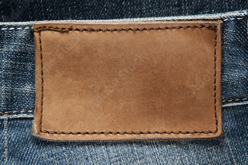 Fotobehang Stof Blank leather jeans label