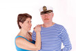 Middle aged couple posing as sailors