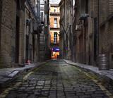 Fototapeta Uliczki - Looking down a long dark back alley
