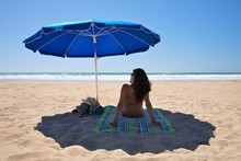 Parasol With Woman Sit On Towel