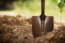 Shovel In Soil. Closeup, Shallow DOF.