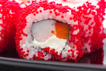 Fototapeta sushi with red caviar..