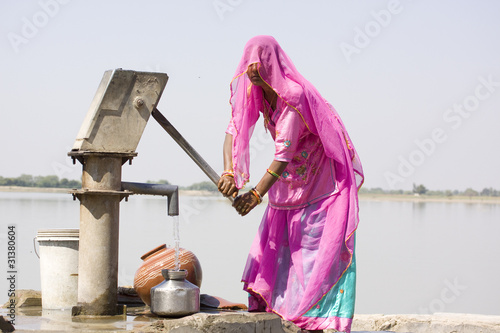 Fotografija woman filling drinking water, Rajasthan , India