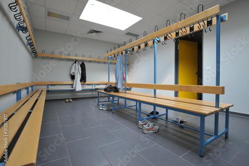 Fototapeta  Kleidungsstücke hängen im Umkleideraum