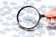 Magnifying Glass And Puzzle