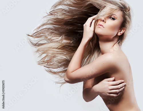 Obraz Beautiful lady with long blond hair - fototapety do salonu