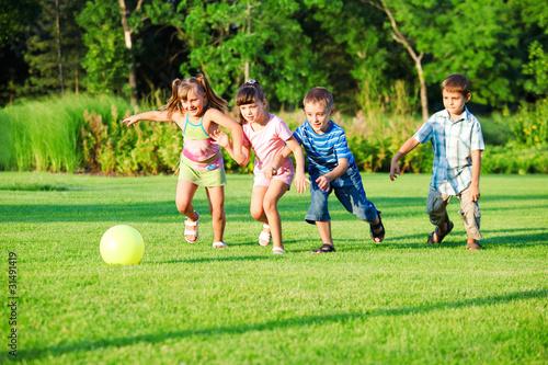 Kids group playing with ball © 2xSamara.com