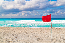 Red Warning Flag On A Stormy B...