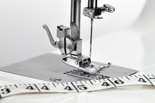 Sewing Machine With A Measuring Tape