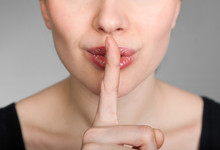 Girl Making A Hush Gesture
