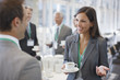 canvas print picture - Businesswoman drinking coffee and talking to co-worker