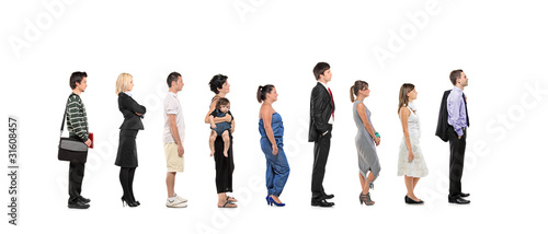 Fotografie, Obraz  Full length portrait of men and women standing together in a lin