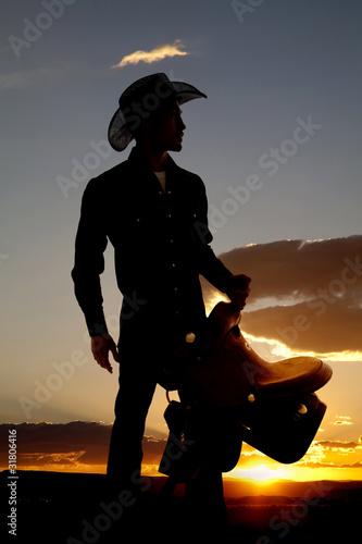Valokuva  Cowboy silhouette with saddle