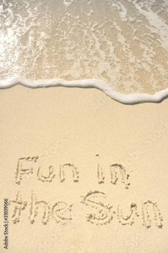Photo sur Toile Plage Fun in the Sun Written in Sand on Beach