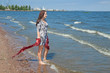 young woman walks on the beach