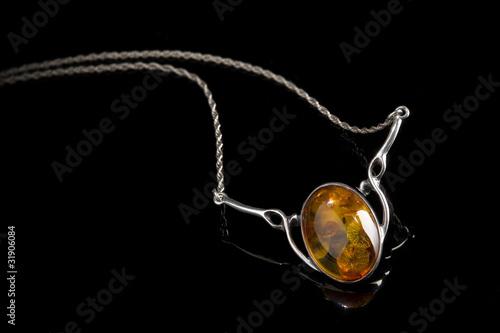 Fotografija amber pendant on silver necklace