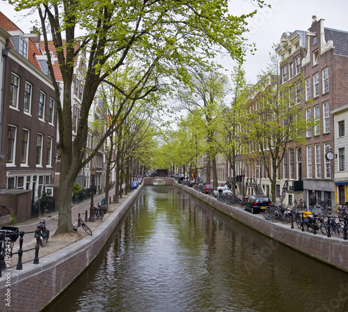 Canal in Amsterdam. Spring cityscape. Canvas Print