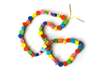 Handmade Necklace From Colourful Beads On A White Background