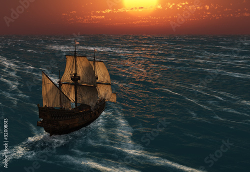 Fotografija  ancient sailing ship at sunset