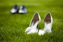 Wedding Shoes In The Grass Field