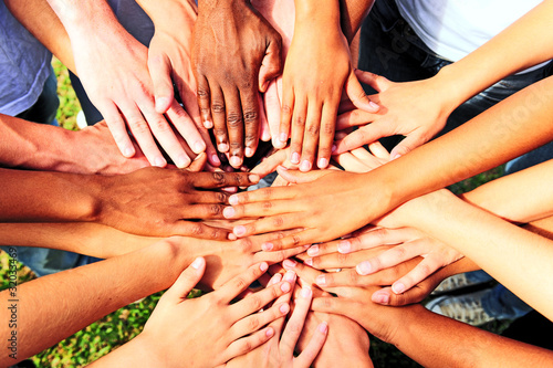 Fotografie, Obraz  many hands together: group of people joining hands