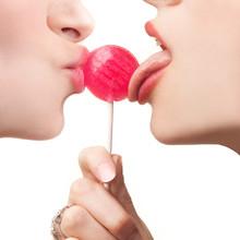 Two Beautiful Women Licking An...