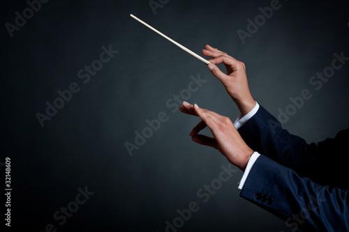 Fotografiet  male orchestra conductor