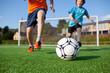 canvas print picture - zwei jungs spielen fußball