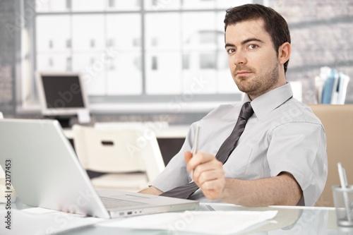 Garden Poster Young man sitting at desk using laptop