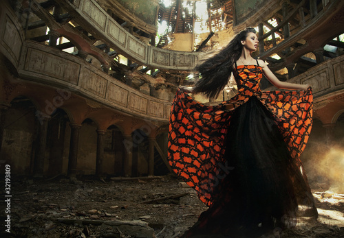 Photo  An actress in old, abandon theater