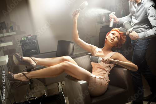 Young woman posing in hairdresser room