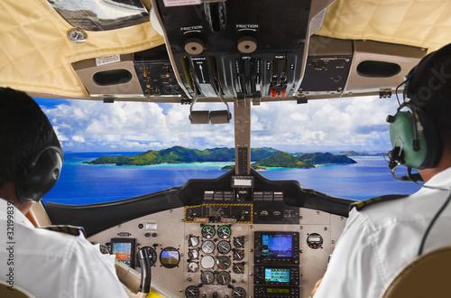 Fotografie, Obraz  Pilots in the plane cockpit and island