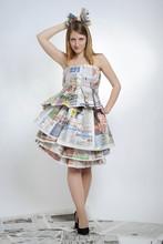 Girl In Newspaper Dress
