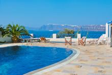 Blue Swimming Pool In Fira On Island Of Santorini, Greece.