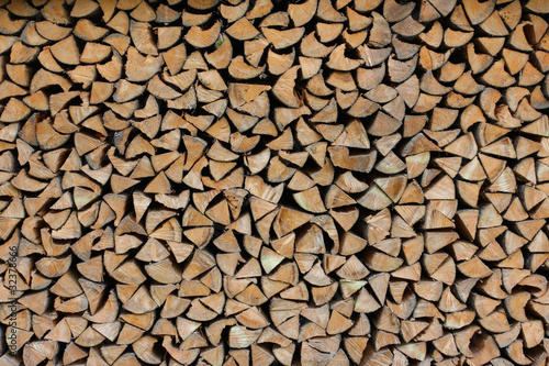 In de dag Brandhout textuur background made of cumulate firewood close up