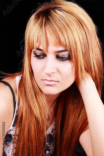 Photo  nachdenkliche junge Frau