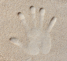 Hand Print In Sand