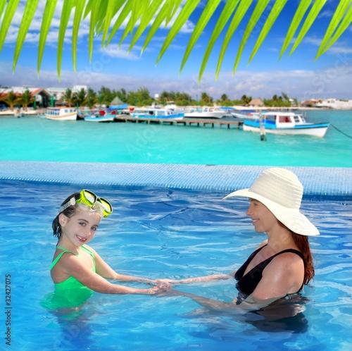 Foto op Plexiglas Caraïben daughter and mother in swimming pool tropical