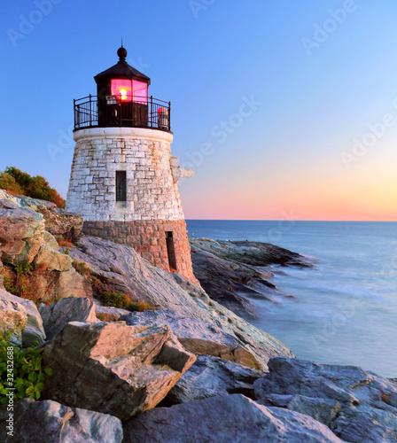 Foto op Aluminium Vuurtoren Lighthouse at sunset