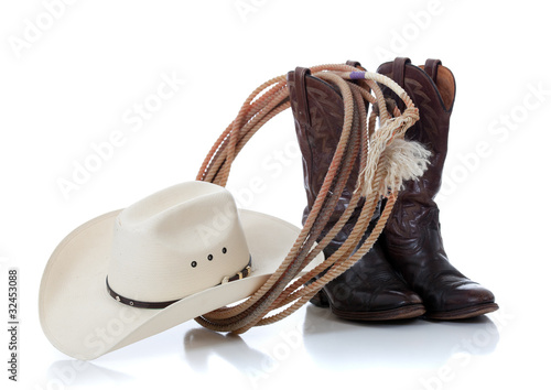 Fotografia, Obraz  Cowboy hat, boots and lariat on white