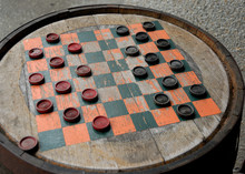 Game Of Checkers On Old Fashion Wooden Barrel