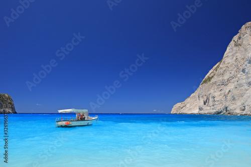 Boat anchored on Navagio beach, Zakynthos island, Greece фототапет