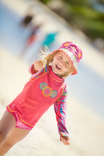 A Happy Young Girl At The Beac...