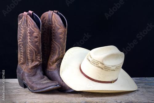 Fotografia, Obraz  cowboy boots and cowboy hat still life