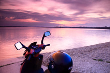 Sun Set At The Lake And A Moped