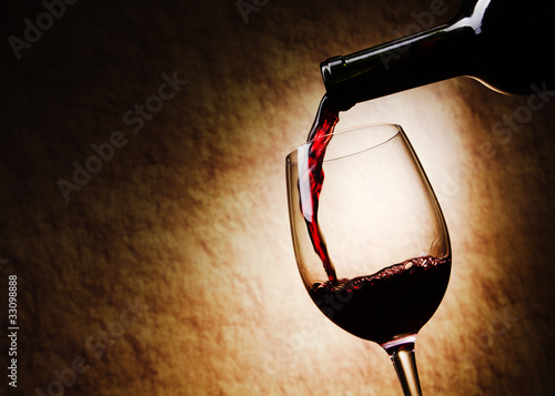 Staande foto Alcohol Red Wine glass and Bottle