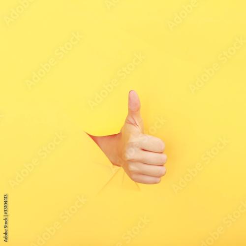 Fototapeta Hand aus der Wand