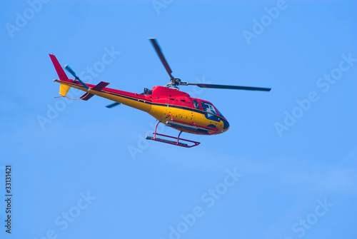 Tuinposter Helicopter AS.350 helicopter in flight
